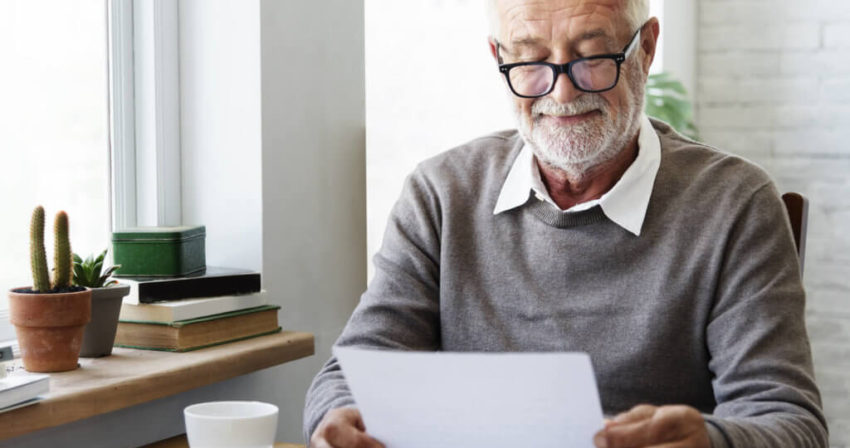 Senior adult reading letter